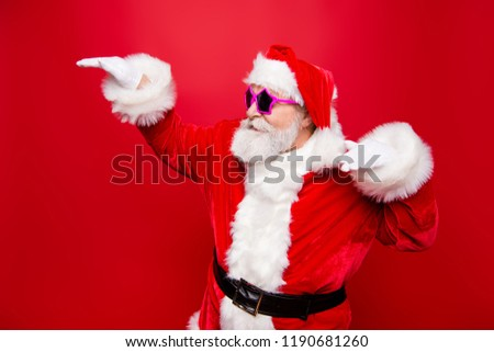 Profile side view cheerful positive carefree careless happiness aged mature Santa headwear tradition costume fooling around under music raised hands up isolated on noel red background #1190681260