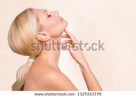 Profile side view half face portrait of nice attractive nude naked woman perfect smooth soft smooth neck lifting massage facial recovery closed eyes isolated over beige pastel background