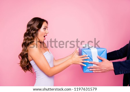 Profile side view of glad nice attractive cute gorgeous cheerful bright vivid shiny stylish wavy-haired girl in cocktail dress, receiving gift, isolated over pink background
