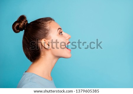 Profile side view photo of pretty youngster glad content enjoy shout news open mouth look up ads wear modern millennial pullover beautiful spring isolated on blue background Stock photo ©