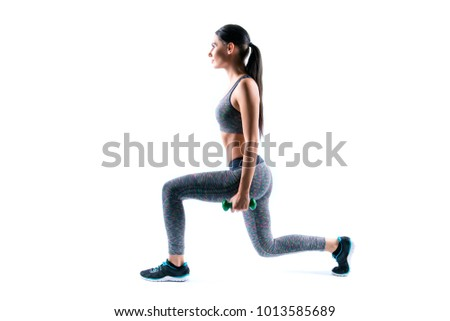 Profile side view photo of slender beautiful young sportive attractive happy woman with ponytail, she is crouching on legs with dumbbells, isolated on white background, copyspace