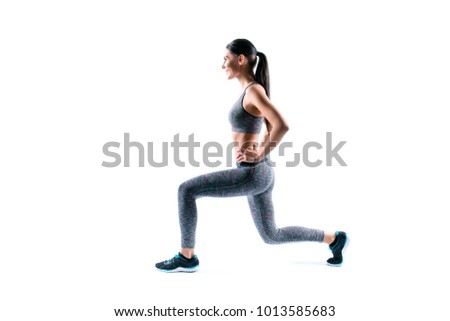 Profile side view photo of smiling beautiful charming full of energy sport woman, she is doing exercise to build muscles on her legs, isolated on white background, copyspace