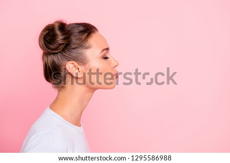 Profile side view portrait of her she nice cute attractive lovely sweet cheerful girl lady kissing you isolated over pastel pink background