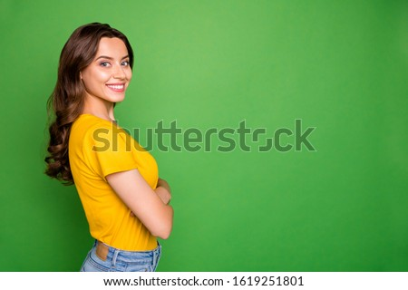 Profile side view portrait of nice attractive lovely lovable charming pretty cheerful cheery wavy-haired girl folded arms copy space isolated on bright vivid shine vibrant green color background