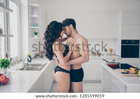 Profile side view portrait of nice attractive tender gentle delicate married spouses guy sporty figure slim fit wavy-haired lady affection date feelings cupid in light white interior