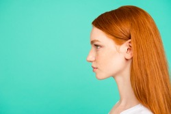 Profile side view portrait of nice positive calm content attractive cute bright vivid shiny red straight-haired girl in casual white t-shirt, isolated on turquoise green teal pastel background