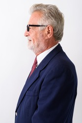 Profile view of happy senior bearded businessman smiling while wearing eyeglasses against white background