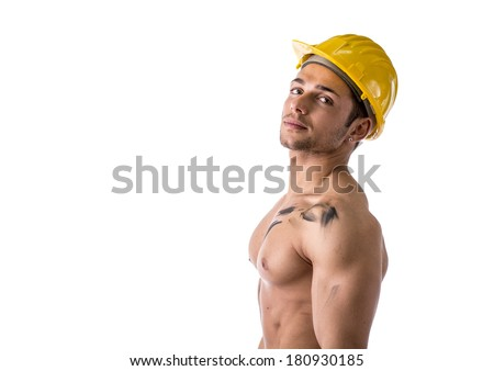 Profile view of muscular young construction worker shirtless wearing hardhat