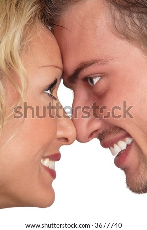 Profiles of beautiful blondie and brunet looking at each other and laughing