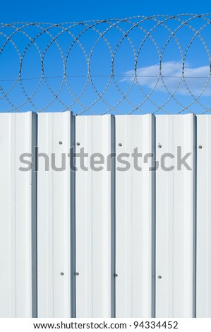 profiling a metal fence with barbed wire