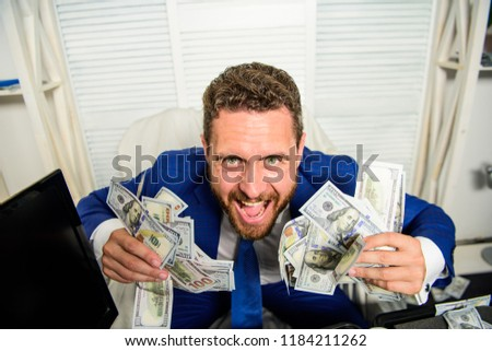Profit and richness concept. Businessman formal suit hold cash dollars hands. Che k out my profit this month. Earn money easy business tips. Man cheerful happy businessman with pile dollar banknotes. Stock foto ©