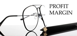 PROFIT MARGIN text. Glasses and pencil isolated on the white background