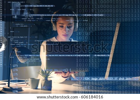Program development concept. Young woman listening to music while working with laptop