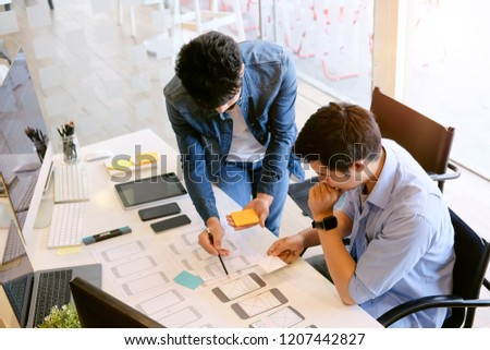 Programer Team working development software with UX UI project in computer and paper project. #1207442827
