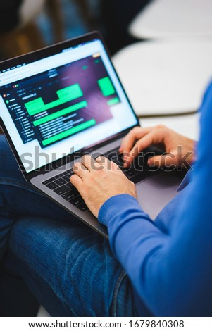 programmer coder working on his laptop. Software development. Programmer coding web application client server. Developer of program code. process of writing code in a special application.