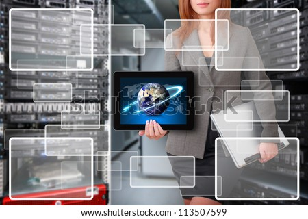 Programmer hold tablet and window icon in server room : Elements of this image furnished by NASA