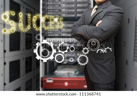 Programmer in data center room and gear to success