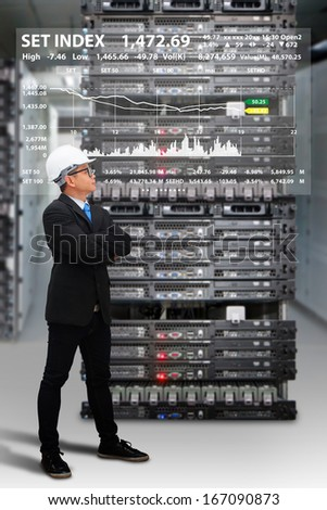 Programmer in data center room and graph report