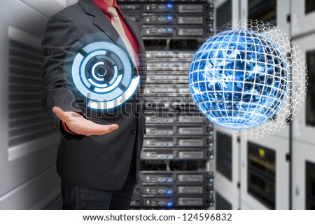 Programmer in data center room and world control icon : Elements of this image furnished by NASA