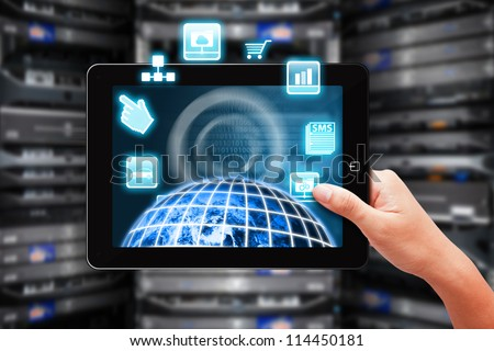 Programmer present the world control through digital touch pad in data center room : Elements of this image furnished by NASA