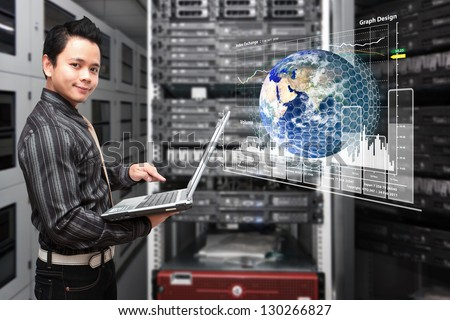 Programmer take control the graph report in data center room : Elements of this image furnished by NASA