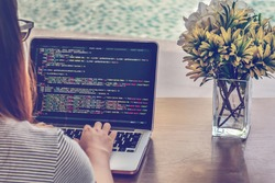 Programmer Typing New Lines of HTML Code. Laptop and Hand Closeup. Working Time. Web Design Business and Web Development Concept. Relaxing Environment. Freelance Work. Programming for all Genders.