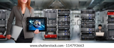 Programmer waiting for service in data center room : Elements of this image furnished by NASA