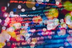 Programmer working in a software develop company office. Digital binary data on computer screen. Computer script typing work. Programming code abstract screen of software developer.