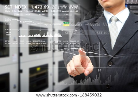 Programmers in data center room and touch on graph report