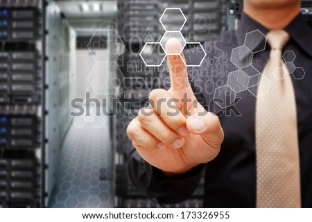 Programmers in data center room and touch the power button