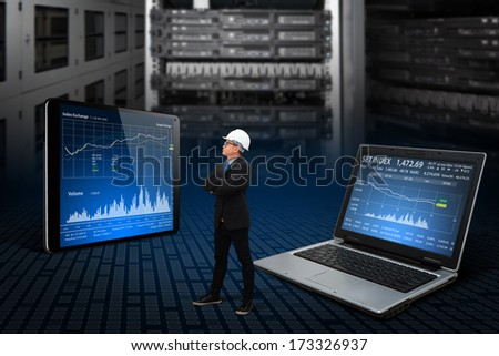 Programmers in data center room working with laptop and tablet
