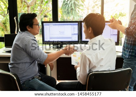 Programmers team handshaking after good deal software developing. Developing programming and coding technologies. Website design. Cyber space concept.