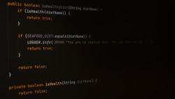 Programming code screen. Dark theme of IDE, dark mode of code editor. Writing programming code on laptop.