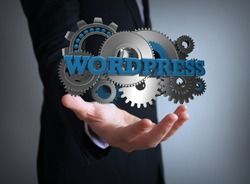 programming concept: text wordpress with gears over businessman hand