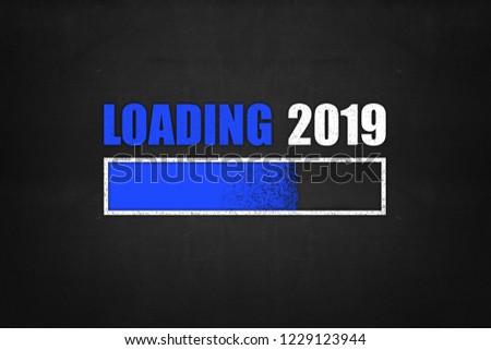 progress bar showing loading of 2019 drawn on a chalkboard #1229123944