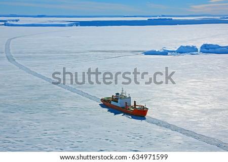 Stock Photo Progress station, Antarctica  January 20, 2016: Cargo ship arrives in port for unloading on an ice floe. Antarctic.