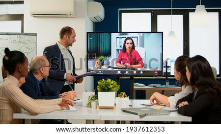 Project manager presenting company ceo discussing on at webcam during virtual business presentation. Confident businesswoman talking to web cam streaming webcast training, doing online conference call