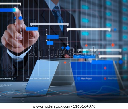 Project manager working and update tasks with milestones progress planning and Gantt chart scheduling virtual diagram.businessman hand pressing a touchscreen button on server background. #1165164076