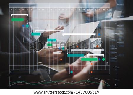 Project manager working and update tasks with milestones progress planning and Gantt chart scheduling virtual diagram.StartUp Programming Team. Website designer working digital tablet dock keyboard.