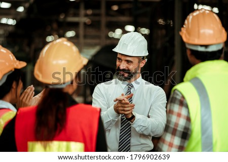 Project Manger boss talking with worker and staff in factory smile and happy Stock photo ©