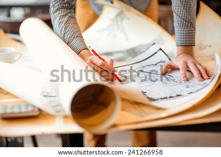 Shutterstock Projecting with pencil on the big urban drawings. Town planning