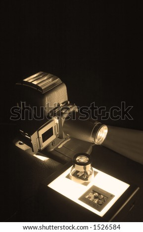 Projector, Lupe, Slides & Lightbox lit low-key and sepia toned