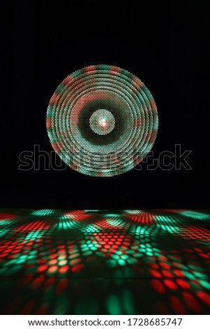 Projector of light rays. Colorful light show on black background. stock photo