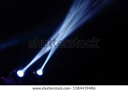 projector spotlights in smoke texture . lights beam for showing presentation . production and director multimedia background . #1384439486