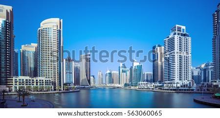 Promenade and canal in Dubai Marina with luxury skyscrapers,Dubai,United Arab Emirates #563060065