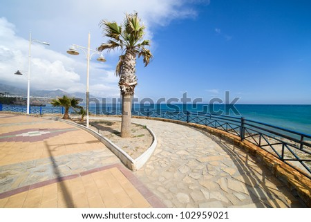 Promenade by the Mediterranean Sea in resort town of Nerja at Costa del Sol, southern Andalusia, Spain.