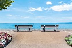 Promenade with Benches and Flowers  in Bardolino, Italy, Garda Lake.Lago di Garda