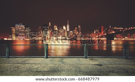 Promenade with view of Manhattan skyline at night, color toning applied, New York City, USA. #668487979
