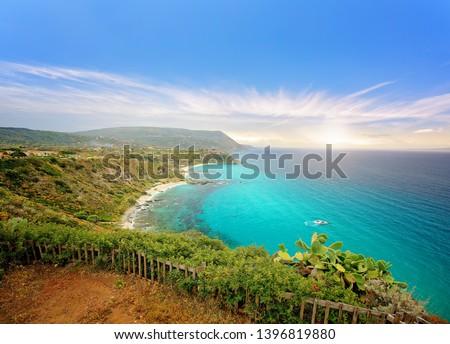 Promontory of Capo Vaticano Ricadi at sunset. Jagged coastline, azure sea and sandy beaches - Calabria, Italy #1396819880