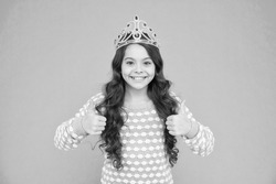 Promoting your content. Happy child give thumbs ups blue background. Princess girl wear crown. Promoting product or service. Sales promotion. Promoting and advertising. Approving and promoting